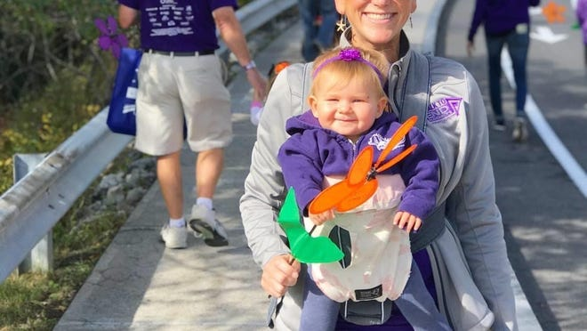 Kimberly Smith, of Victor, participates in the Walk to End Alzheimer's in memory of her mother, who died of younger-onset dementia.