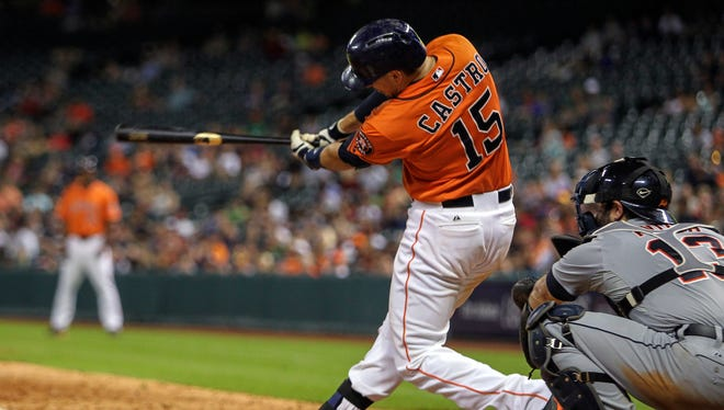 Houston Astros catcher Jason Castro (15) hits a game winning home run during the eleventh inning to defeat the Detroit Tigers 4-3 at Minute Maid Park.