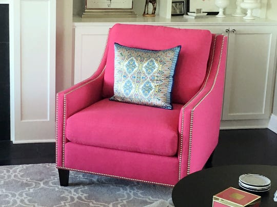 """""""Statement chairs"""" can brighten up a room with a spot of vivid color."""