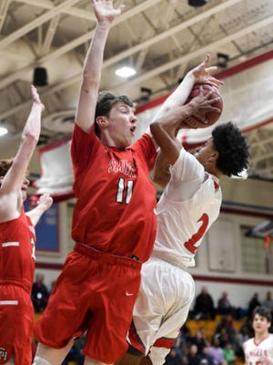 Will Becker (11) of the Smoky Hill Buffaloes blocks Daylen Kountz (2) of the East High Angels during the first half of their class 5A round of 16 game on Wednesday, February 28, 2018.