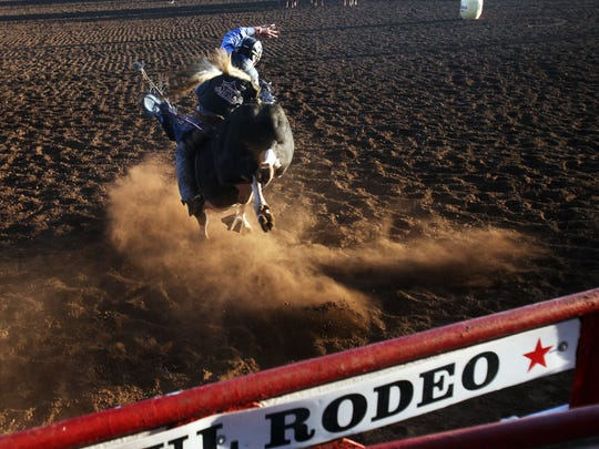 Colby Reilly rides for a score of 86.5 at the Pro Bull Riders event at the St. Paul Rodeo on Thursday, June 30, 2011.