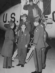 Army Staff Sgt. James Pfister (bottom center) returns to the United States by way of Fort Knox, Ky., after spending nearly five years in a North Vietnamese prison camp in 1973.