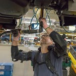Ford tries out exoskeletal vests to lessen strain for assembly line workers
