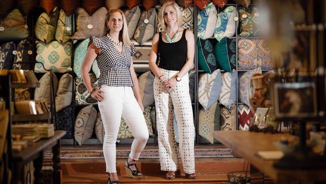 Erika Kurtz, left, wearsJoe's white jeans; J Crew Gingham top and Michael Kors black leather shoes with cork wedge. Her sister Josephine, right, wears ivory Anthropologie linen pants with multicolored embroidered polka dots, a black cotton tank from Trudy and DV leather and cork wedges.