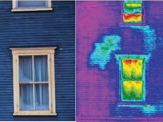 Almost X-ray vision: An older building's heat loss is measured (at right) with the help of an infrared camera in this image supplied by The Snell Group of Barre.