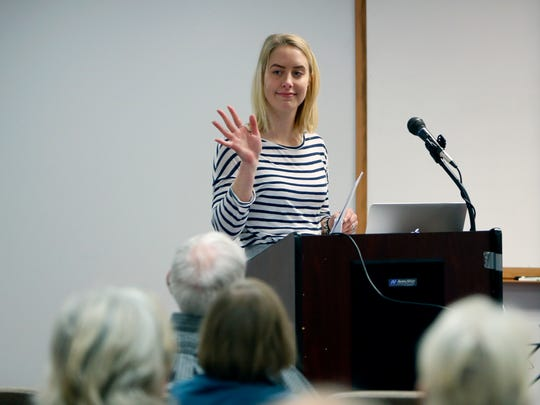Alanna Jacobs is introduced before giving a talk at OASIS about healthy cognitive aging.