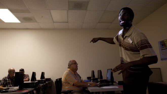 Michael Foust, an unemployment security case manager at Southwest Florida Works, teaches a re-employment training workshop on Dec. 16, 2011.