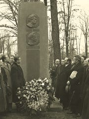 The Cleveland Symphony Orchestra, including conductor Artur Rodzinski, at right with newspaper under arm, visit the Woodlawn Cemetery monument in memory to Ossip Gabrilowitsch, who served as their guest conductor, on Feb. 18, 1938.
