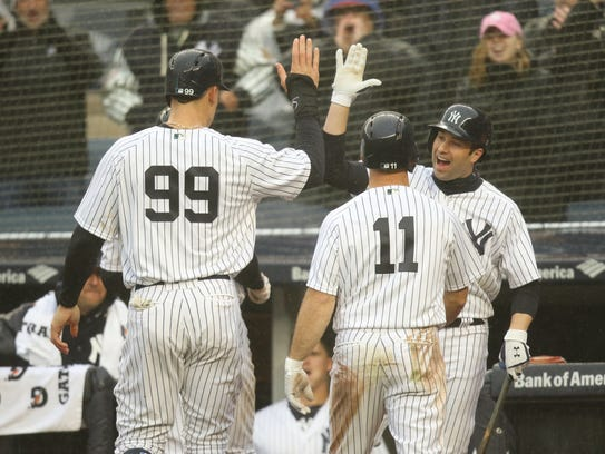 Neil Walker congratulates Aaron Judge (99) after scoring