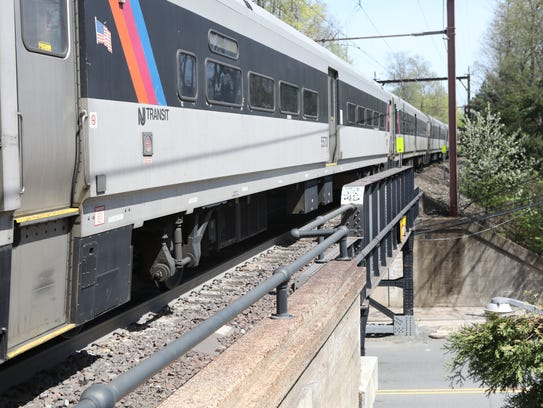 A NJ Transit train is shown as it moves above Fairmount