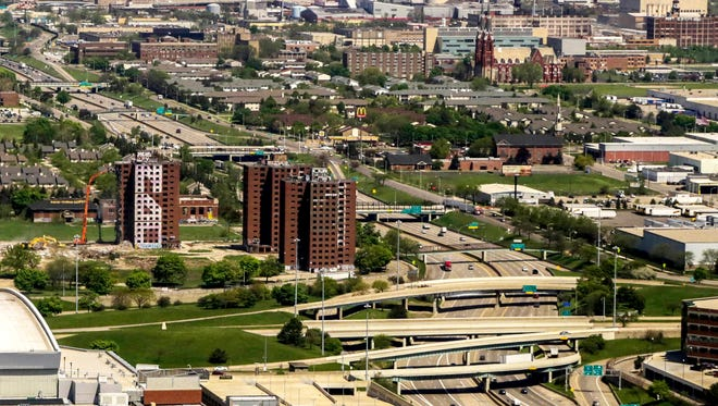 The Brewster-Douglass Housing Projects can be seen on the lower left. I-75 goes north in the picture, and when it was built, it displaced the neighborhood called Black Bottom. Picture from 2014.