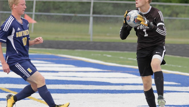 Marysville goalie Brett Robinson catches the ball during their game against Port Huron Northern on Aug. 24.