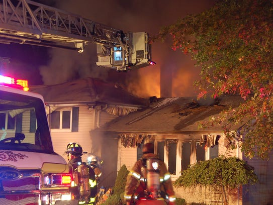 Firefighters on the scene of a blaze early Monday morning