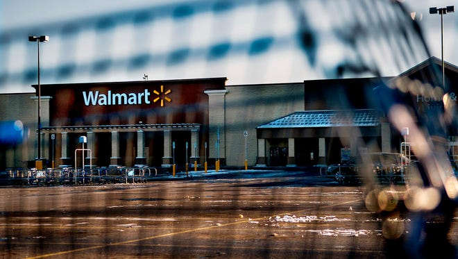 This photo shows Wal-Mart with a shopping cart in the foreground in Hayden, Idaho, Tuesday, Dec. 30, 2014. A 2-year-old boy accidentally shot and killed his mother after he reached into her purse at the northern Idaho Wal-Mart and her concealed gun fired, authorities said Tuesday.