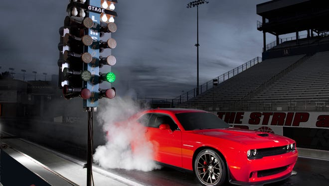 2015 Dodge Challenger SRT Hellcat squeals away from the starting line