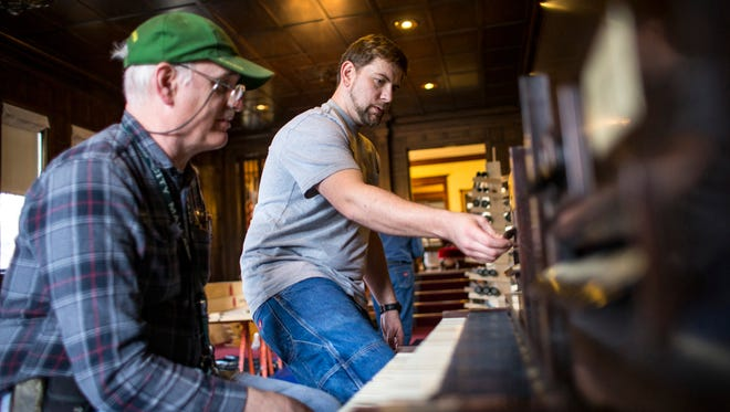 Chris and Matt Levsen sit at the console of the Musser organ at the Muscatine Art Center on March 9, 2017. The organ, built by the Estey Organ Company of Brattleboro, Vt., uses 731 pipes, 11 manual ranks, 2 pedal ranks and a glass harp and can use player rolls, much like a player piano.