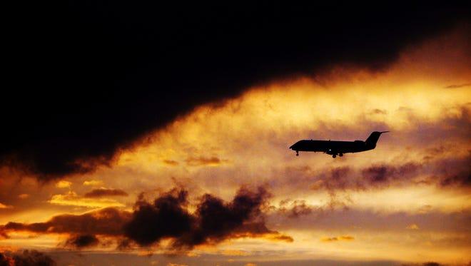 A jet lands at Memphis International Airport.