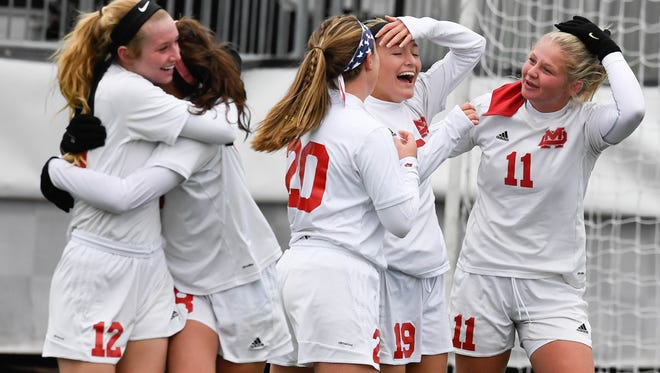 Mater Dei players congratulate Miranda Nosko (19) (second from right) after she scored Mater Dei only goal to win the the Class 1A Girls Indiana High School Athletic Association Soccer State Championship at Michael A. Carroll Stadium in Indianapolis Saturday, October 28, 2017.