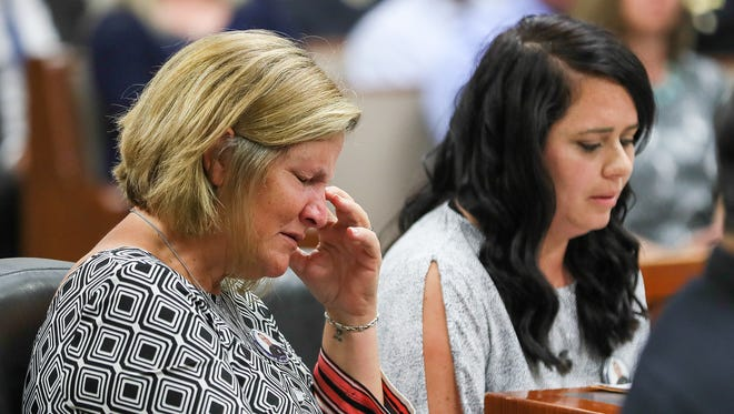 Linda Rodman, Nick Rodman's mother, left, becomes emotional as Ashley Rodman, Nick Rodman's widow, read a prepared statement during the sentencing of Wathaniel Woods, who was charged with his murder, on Friday.June 15, 2018