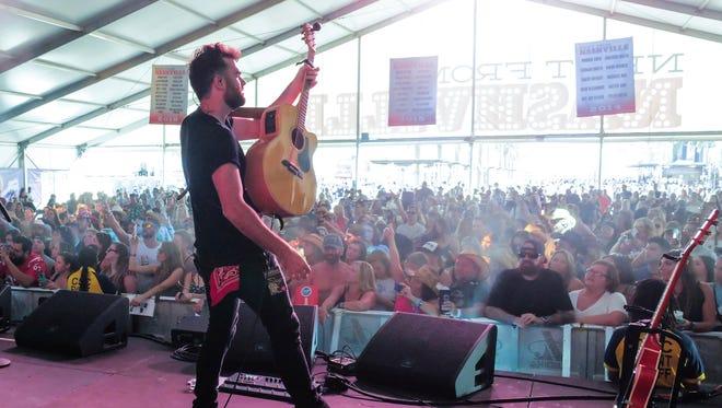 Vermillion native Jordan Merrigan plays guitar for country artist Dylan Schneider at the Route 91 Harvest Festival in Las Vegas.