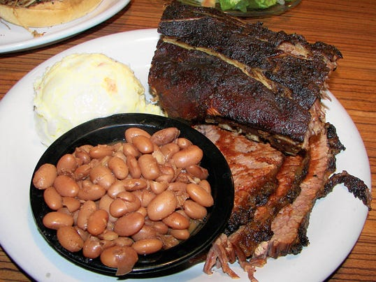 The Two-Meat Platter at Mesilla Valley BBQ Company in Las Cruces is a favorite among patrons. The filling meal features ribs and brisket, plus two sides, like beans and potato salad. The diner picks the meats and sides.