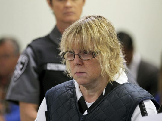 FILE - In this June 15, 2015, file photo, Joyce Mitchell appears before Judge Mark Rogers in Plattsburgh, N.Y., City Court for a hearing. The New York prison worker accused of smuggling hacksaw blades in frozen hamburger meat to two killers who later broke out and spent more than two weeks on the run pleaded guilty to charges of first-degree promoting prison contraband, a felony, and misdemeanor fourth-degree criminal facilitation on Tuesday, July 28, 2015. (G.N. Miller/New York Post via AP, Pool, File)