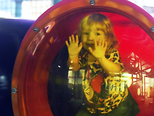 Chloe Naugle, 3, plays Wednesday at Cluggy's Family Amusement Center through the Make-A-Wish Foundation.