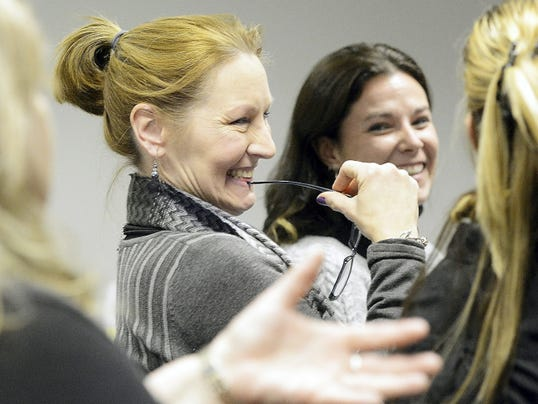 Julie Hess of Keep it Green Recovery and Adriane Shultz of Colonial House, right,  have a light moment with Community Connections facilitator Lori Beyer, left, during the seminar.