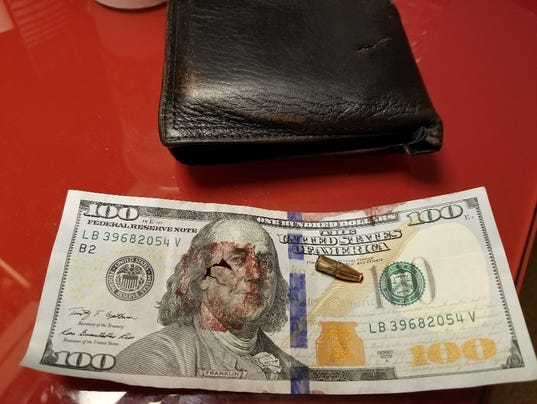 Blood-stained hundred-dollar bill