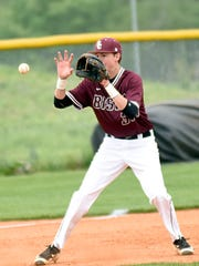Station Camp High senior third baseman Brad Deason fields a fifth-inning ground ball.