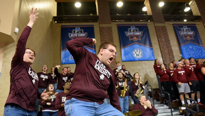 Bellermine University pep band members Daniel Spitza (left) and Alex White react after their team scores against Colorado School of Mines during the NCAA 2017 Division II Men's Elite Eight quarterfinals at the Sanford Pentagon in Sioux Falls, S.D. on Wed., March 22, 2017.
