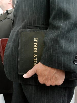 A man holding his Bible.
