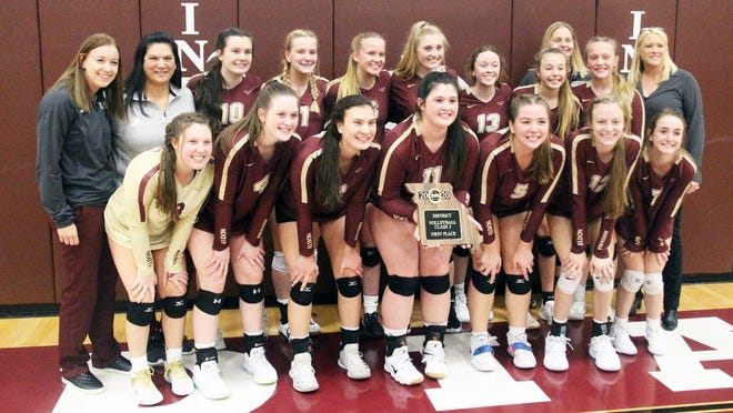 The Eldon volleyball team celebrates its championship in the Class 3 District 9 Tournament on Thursday, October 29, in Osage Beach.