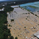 In this August 15, 2016, U.S. Coast Guard handout photo, flooded areas of Baton Rouge, Louisiana, are seen from the air. As many as 30,000 people have been rescued following unprecedented floods in the southern US state of Louisiana, including a 78-year-old woman who spent a night stranded in a tree, police said. Residents awoke August 16 to find their homes and businesses still surrounded by muddy water, without clear answers about when the epic flooding that has killed at least seven is expected to recede. / AFP PHOTO / US Coast Guard / PO1 Melissa LEAKE