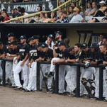 Members of the UCF baseball team watch their teammates play in a game between the Knights and the Tulane Green Wave at Jay Bergman Field on Friday, April 22. The Knights lost 4-3.