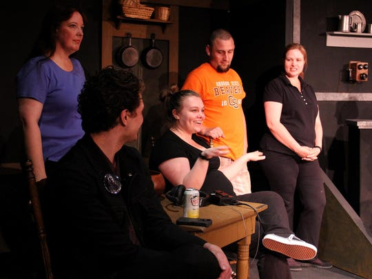 Stage manager Dani Potter (center) responds to a question