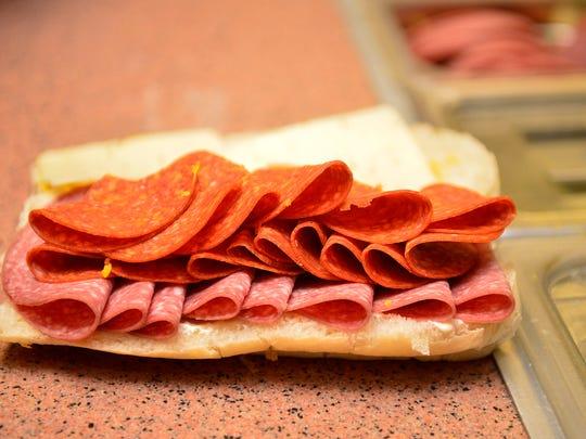 A Montana Sub Shop sandwich under construction.