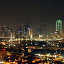 A general view of the skyline of downtown Dallas, Texas as the American Airlines Center can be seen the night before Game Four of the 2011 NBA Finals on June 6, 2011 in Dallas, Texas. NOTE TO USER: User expressly acknowledges and agrees that, by downloading and/or using this Photograph, user is consenting to the terms and conditions of the Getty Images License Agreement  (Photo by Mike Ehrmann/Getty Images)