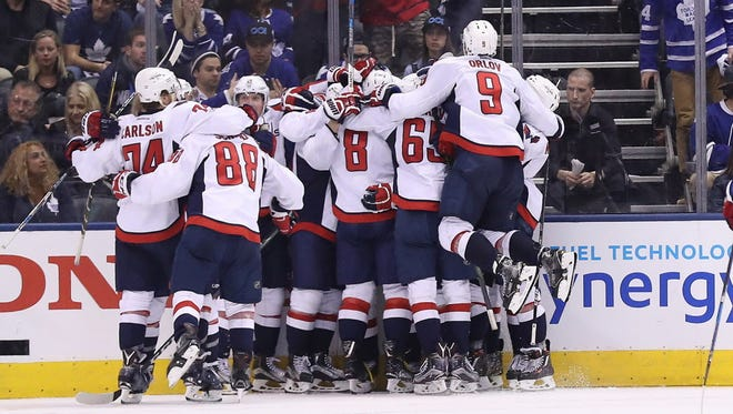 Washington Capitals players celebrate the overtime-winning goal scored by Marcus Johansson (not pictured) against the Toronto Maple Leafs in Game 6.