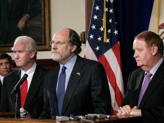Speaker of the New Jersey General Assembly, Joseph J. Roberts Jr, D-Camden, left, New Jersey Gov. Jon S. Corzine and state Senate President Richard J. Codey, right, D-Essex, listen to a question at the Statehouse in Trenton, N.J., Thursday, July 6, 2006, after Corzine announced that the Legislature had come to a compromise agreement on the state budget.