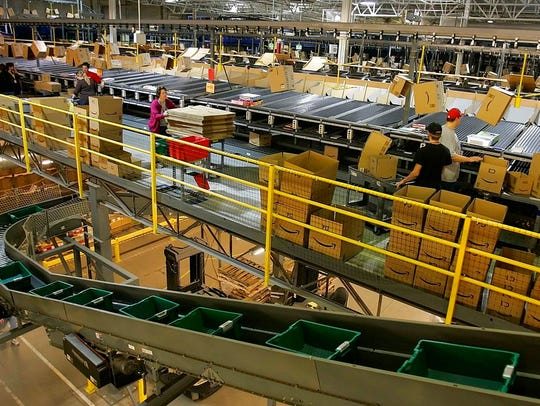 In this Dec. 13, 2005 file photo, workers fill boxes