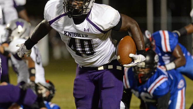 North Webster Devin White runs for a first down against Evangel in the first quarter of a game on October 17, 2014.