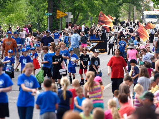 Parade traffic and spectators fill Riverside Avenue during Saturday's SummerFest Parade in Sartell.