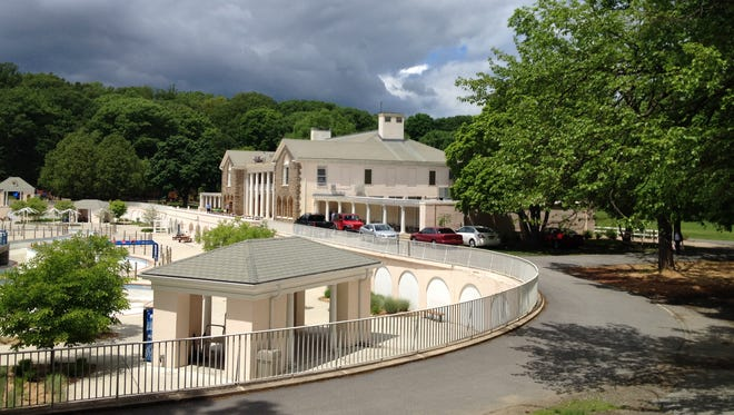 The Tibbetts Brook Park Bath House in Yonkers under threatening skies.