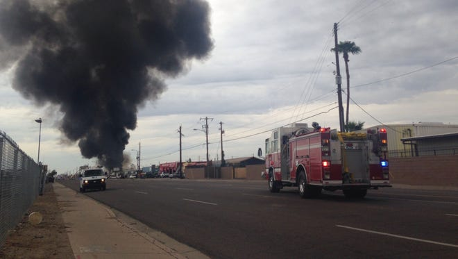 A fire at a South Phoenix industrial business sent up  a large plume of black smoke over the city on Sept. 9, 2015.