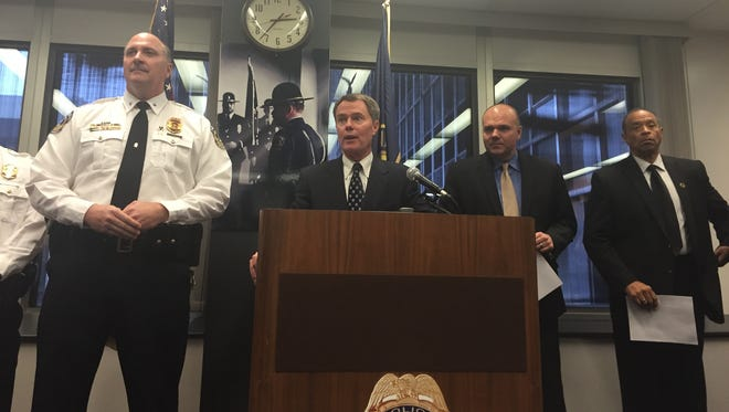 Indianapolis Mayor Joe Hogsett introduced new appointments to the Indianapolis Metropolitan Police Department's executive staff Friday. He is joined (from left) by Assistant Chief James Waters, Chief Troy Riggs and IMPD Chief of Staff Brian Reeder.