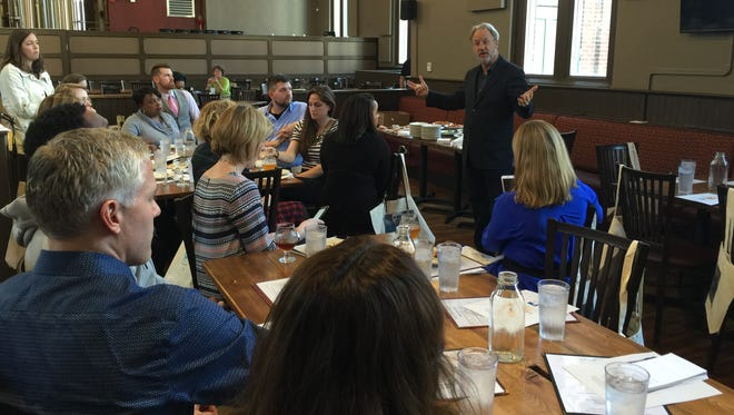 """Brian Payne, president and CEO of the Central Indiana Community Foundation, talks to the Ben Franklin Fund """"mavens"""" on March 15 at St. Joseph Brewery, 540 N College Ave."""