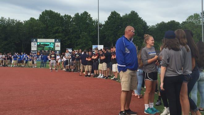 Members of area high school championship teams lined the field at Dutchess Stadium on Monday, including members of the Millbrook High School volleyball team, right, during a pregame ceremony prior to the Hudson Valley Renegades game in Fishkill.