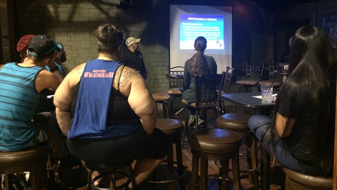 At Stacy's at Melrose, restaurant and nightclub employees watch a presentation by the Phoenix Police Department on active-shooter situations on Sept. 20, 2016.