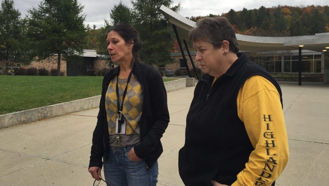 Co-principals of Harwood Union Middle/High School in Moretown, Amy Rex and Lisa Atwood, stand at the schools entrance at the end of a day (Sunday, Oct. 9, 2016) that began with a call by police notifying them that four of their high school students had been killed in a car crash.